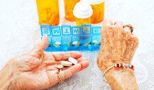 medicines on elderly woman's hand